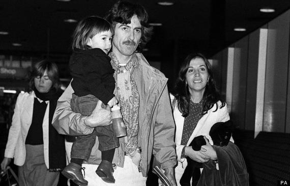 Former Beatle George Harrison, holding their 18-month-old son Dhani, with his Mexican wife Olivia (right) at Heathrow Airport, London, before their flight to New York.  * 30/11/01 It has been announced that George Harrison, the Beatles' quiet lead guitarist and spiritual explorer  has died, a longtime family friend told The Associated Press. Harrison, who wrote While My Guitar Gently Weeps and Here Comes the Sun, was 58.